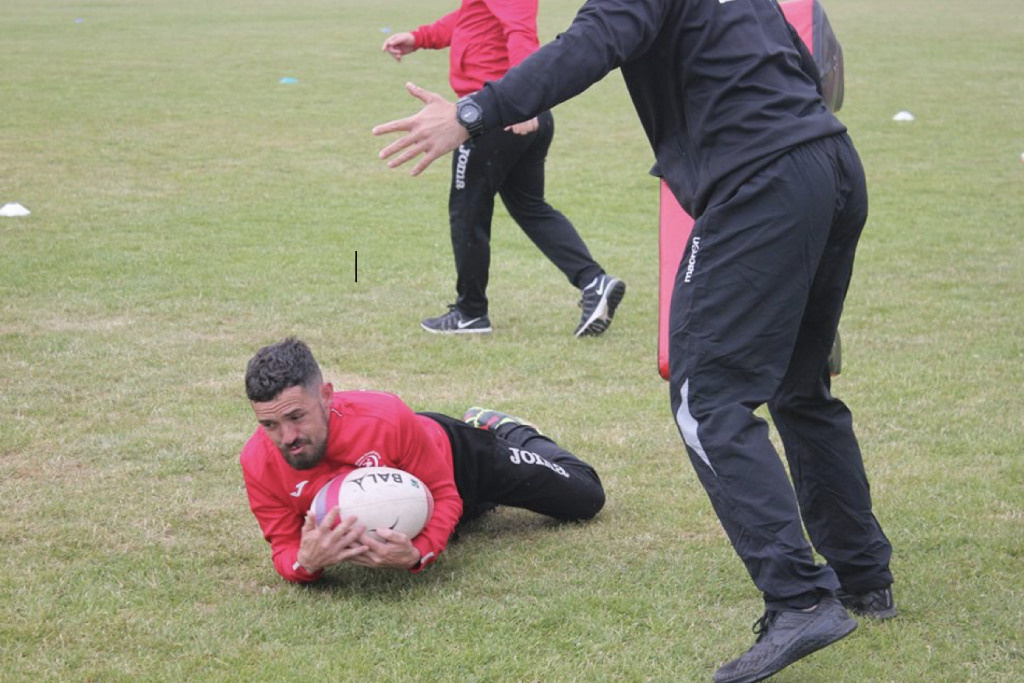 C7 participant taking part in rugby training with a Bala ball