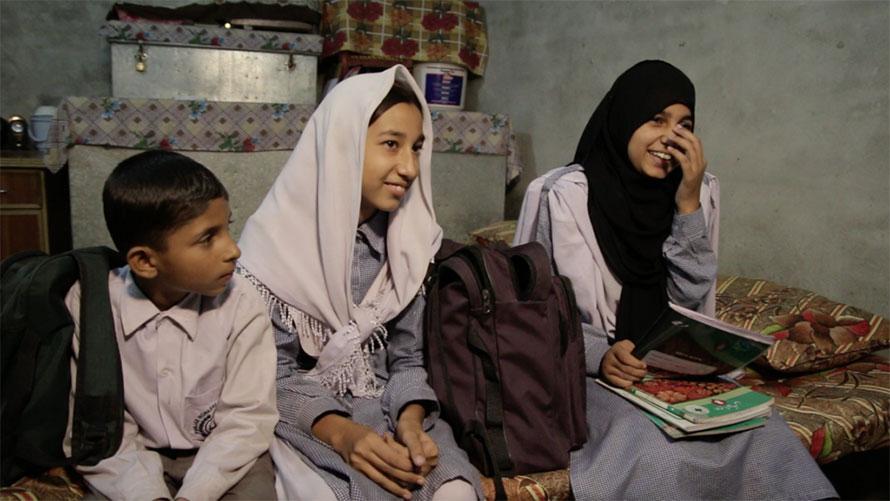 Bala-Sport-Fairtrade-Kids-Showing-Off-School-Packs