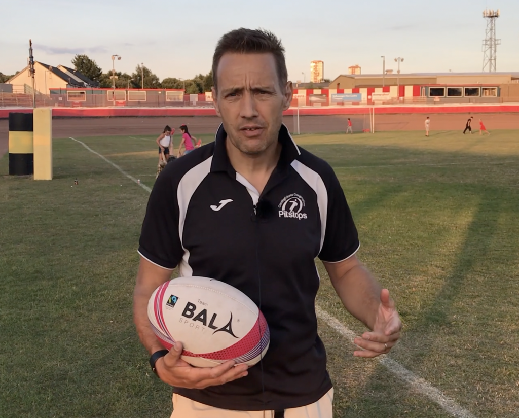 Screen ShotPitstops Project Greg Cann with Bala Sport Fairtrade Rugby Ball